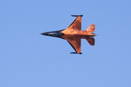 LEEUWARDEN,FRIESLAND,HOLLAND-SEPTEMBER 17: Dutch F-16 Demo Team at the at the�Luchtmachtdagen� Airshow on September 17, 2011 at Leeuwarden Airfield,Friesland,Holland