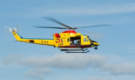 "leeuwarden: LEEUWARDEN,FRIESLAND,HOLLAND-SEPTEMBER 17: Agusta AB-412 SP Helicopter at the ""Luchtmachtdagen"" Airshow on September 17, 2011 at Leeuwarden Airfield,Friesland,Holland"