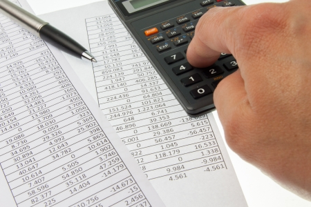 Hand working on a calculator for accounting purposes Stock Photo