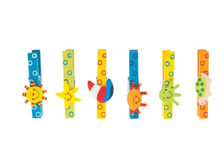 colored clothespin with wooden figures standing in a row isolated on white background photo