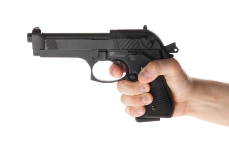 A hand is holding a gun Stock Photo