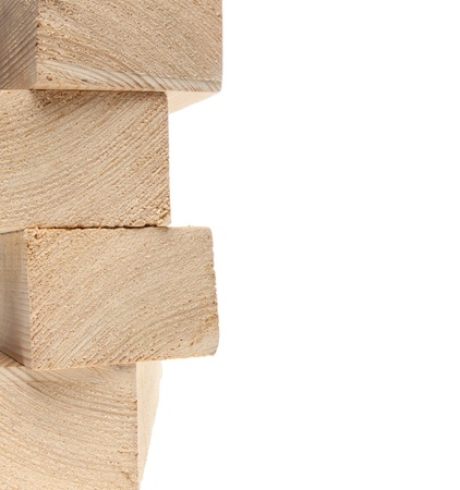 2x4: Stack of wooden 2X4s on white background with copy space.