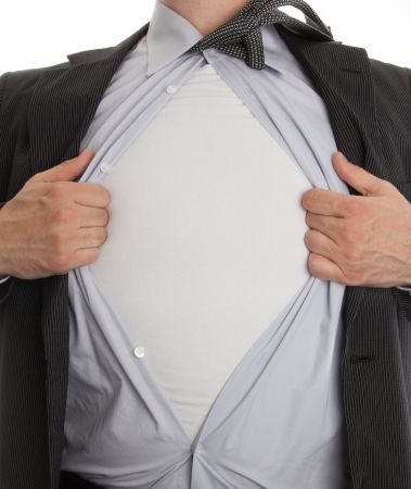 Cropped view of frustrated business man tearing off his shirt on white background photo