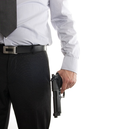 Man in suit with a gun in his hand isolated on a white background
