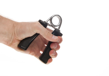 hand gripper: Exercising with a hand gripper isolated on a white background