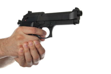 finger on trigger: Two hands holding a gun with finger on the trigger on a white background