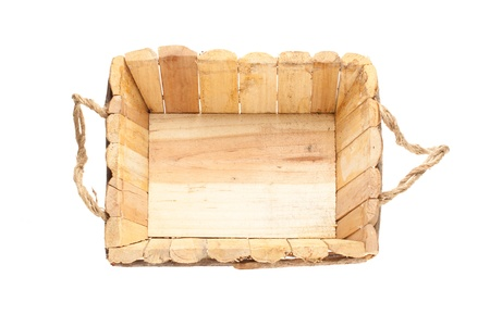 Empty wooden basket on a white background photo
