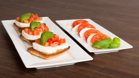 Fresh and tasty bruschetta served on a white plate photo