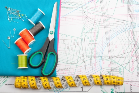 Colorful sewing concept with different kinds of sewing tools photo