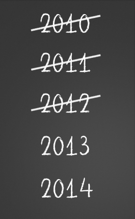 2012 crossed and new year 2013 written on chalkboard photo