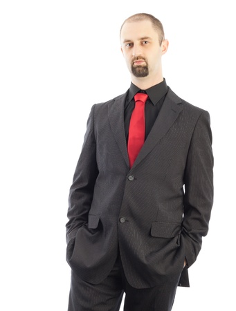 young businessman standing with his hands in the pockets
