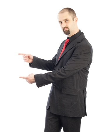 young businessman pointing towards copy space Stock Photo - 15763320