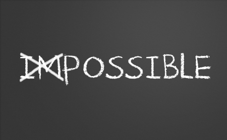 Changing impossible into possible on a chalkboard photo