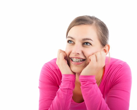 braces: Attractive thoughtful young woman looking up, isolated over white