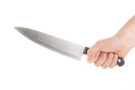 Hand with knife isolated on white Stock Photo - 16528523