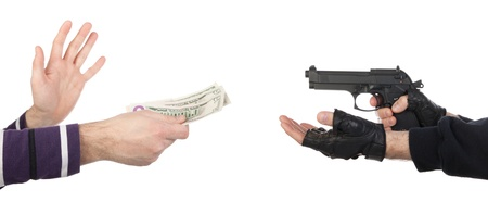 Robber with gun taking money from victim against a white background