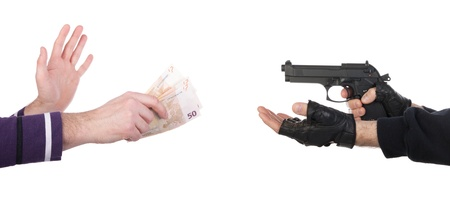 Robber with gun taking money from victim against a white background Stock Photo - 16797551