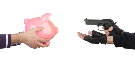 Robber with gun taking piggy bank from victim against a white background Stock Photo - 16797548