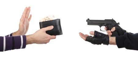 Robber with gun taking wallet from victim against a white background Stock Photo - 16797552