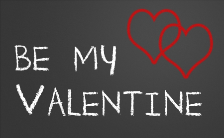 Be my valentine with two red hearts on a chalkboard photo