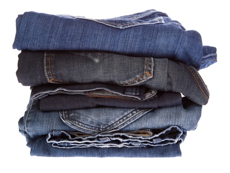 Lot of different blue jeans close-up isolated on white Stock Photo - 17099115