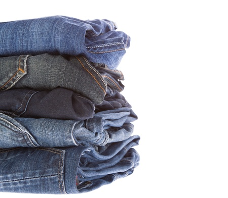 Lot of different blue jeans close-up isolated on white Stock Photo - 17099113
