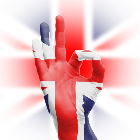 Hand OK sign, wrapped in the flag of the UK Stock Photo - 17427833