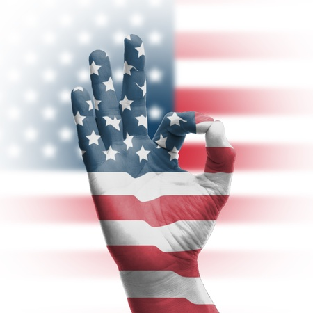hand OK sign, wrapped in the flag of the USA