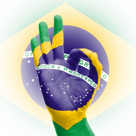 hand OK sign, wrapped in the flag of Brazil Stock Photo - 17427880