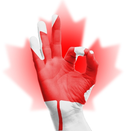hand OK sign, wrapped in the flag of Canada Stock Photo - 17427858