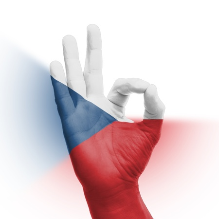 hand OK sign, wrapped in the flag of the Czech Republic Stock Photo - 17427857