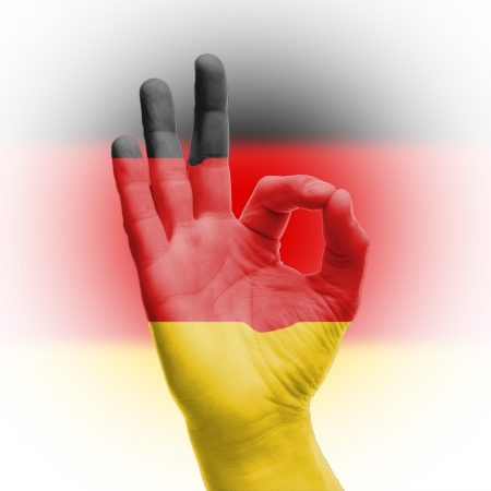 hand OK sign, wrapped in the flag of Germany Stock Photo - 17427878