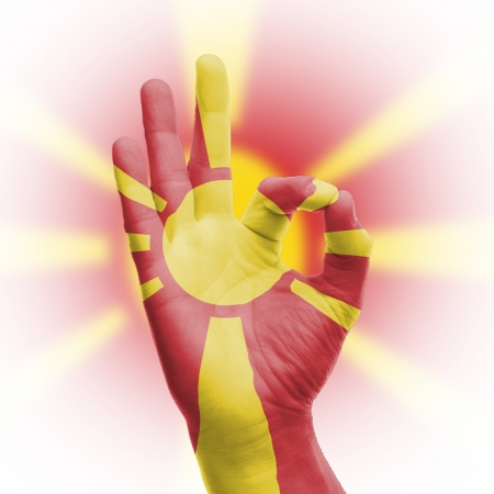 hand OK sign, wrapped in the flag of Macedonia Stock Photo - 17427861
