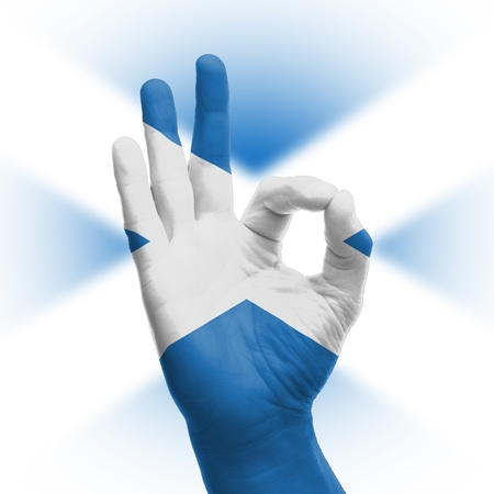 hand OK sign, wrapped in the flag of Scotland photo