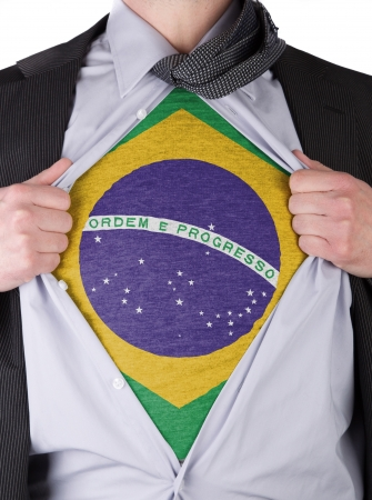 Business man rips open his shirt to show his Brazilian flag t-shirt Stock Photo - 17427896