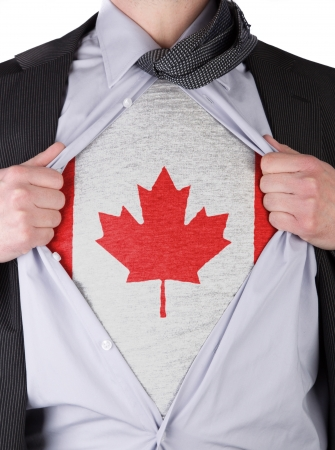 Business man rips open his shirt to show his Canadian flag t-shirt photo