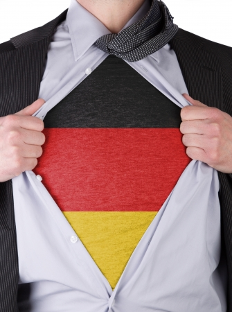 Business man rips open his shirt to show his German flag t-shirt Stock Photo - 17427887