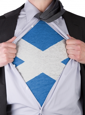 Business man rips open his shirt to show his Scottish flag t-shirt Stock Photo - 17427886