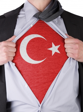 Business man rips open his shirt to show his Turkish flag t-shirt Stock Photo - 17427892