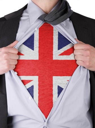 Business man rips open his shirt to show his English flag t-shirt Stock Photo - 17427893
