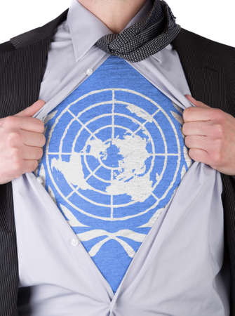 Business man rips open his shirt to show his UN flag t-shirt Stock Photo - 17427894