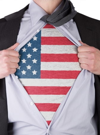 rips: Business man rips open his shirt to show his USA flag t-shirt