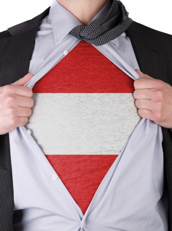 Business man rips open his shirt to show his Austrian flag t-shirt Stock Photo - 17541376