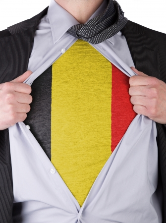 Business man rips open his shirt to show his Belgian flag t-shirt Stock Photo - 17541366