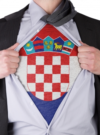 Business man rips open his shirt to show his Croatian flag t-shirt Stock Photo - 17541362