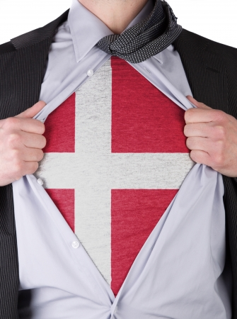 Business man rips open his shirt to show his Danish flag t-shirt Stock Photo - 17541360