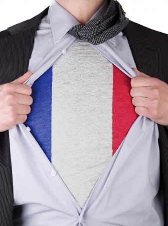Business man rips open his shirt to show his French flag t-shirt Stock Photo - 17541375