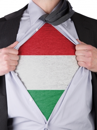 Business man rips open his shirt to show his Hungarian flag t-shirt Stock Photo - 17541357