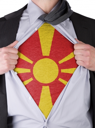 Business man rips open his shirt to show his Macedonian flag t-shirt Stock Photo - 17541367