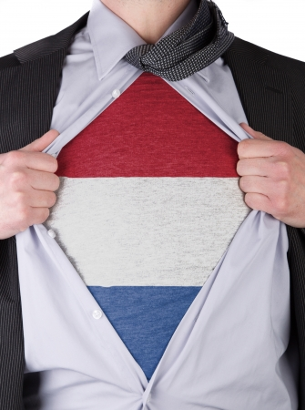 Business man rips open his shirt to show his Dutch flag t-shirt Stock Photo - 17541358